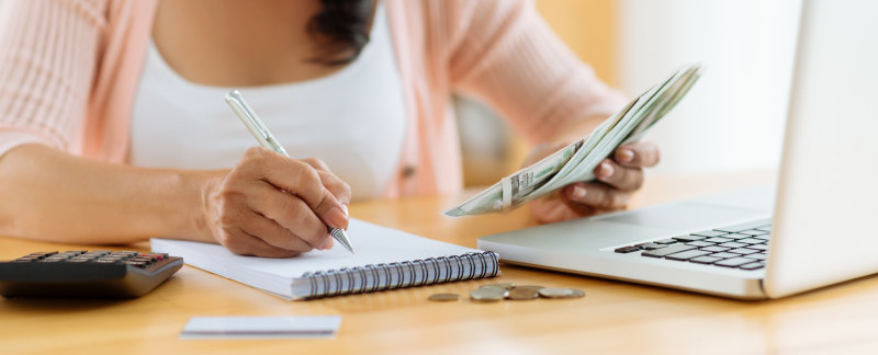 Woman working out her finances for egg freezing